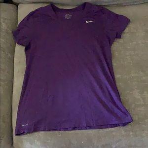 Purple Nike workout shirt.